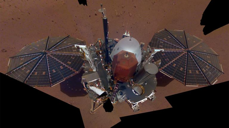"NASA InSight's first full ""selfie"" on Mars, taken Dec. 6, 2018, displays the lander's solar panels and deck. On top of the deck are its science instruments, weather sensor booms and UHF antenna. (Credit: NASA / JPL-Caltech)"