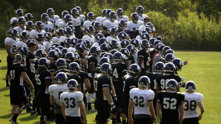 Northwestern football players gather during practice at the University of Wisconsin-Parkside campus in Kenosha, Wisc., in this Monday, Aug. 17, 2015, file photo. (AP Photo / Jeffrey Phelps, File)
