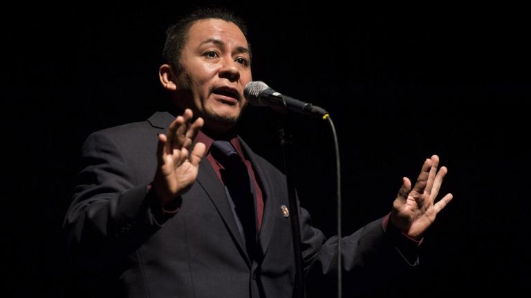 "Nestor Gomez tells his story ""Growing Another Heart"" at a Moth StorySlam. (Credit: The Moth)"