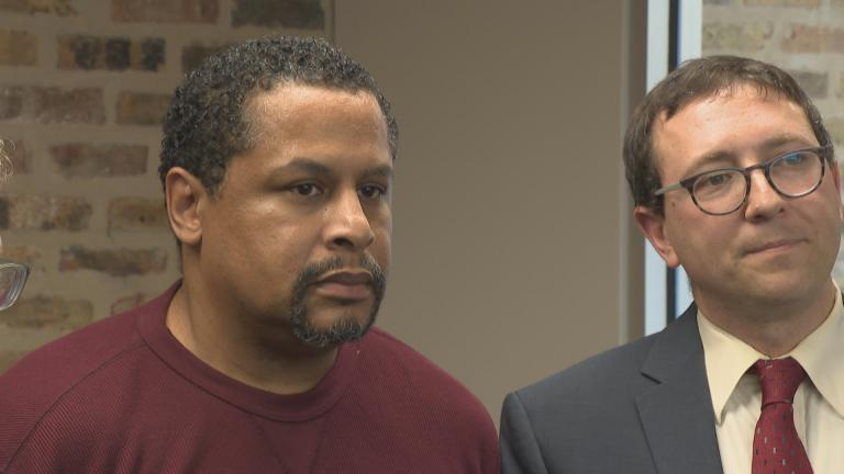 Nevest Coleman, left, stands with his attorney, Russell Ainsworth. (Chicago Tonight)