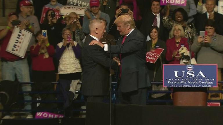 Donald Trump shakes the hand of retired Marine Gen. James Mattis. (Courtesy of CNN)