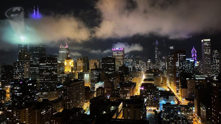 "The iconic bat signal seen above the city skyline as ""The Batman"" films in Chicago. (Photo submitted by Nick Murphy)"