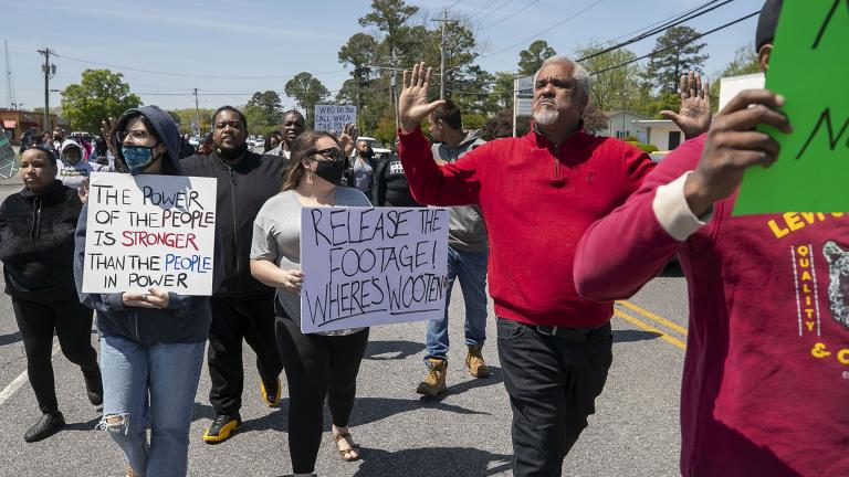 Kirk Rivers leads a group of demonstrators as they block Ehringhaus Street, a main retail avenue in Elizabeth City, N.C., Friday, April 23, 2021, as they demand after a fatal shooting that body camera video be released by the Pasquotank Sheriff's office. (Robert Willett / The News & Observer via AP)