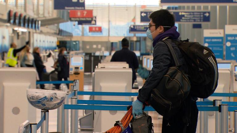 A passenger waits in line at O'Hare International Airport on Wednesday, April 29, 2020. (WTTW News)