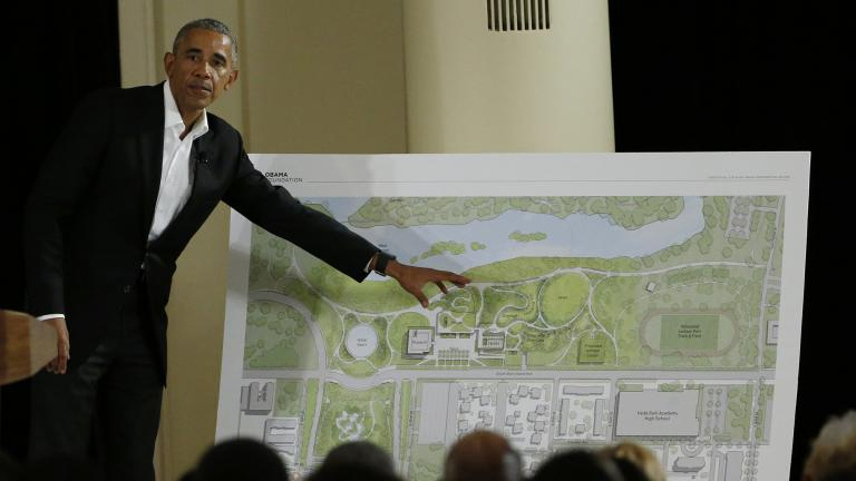 In this May 3, 2017, file photo, former President Barack Obama points to a rendering for the former president's lakefront presidential center at a community event at the South Shore Cultural Center in Chicago. (AP Photo / Nam Y. Huh, File)