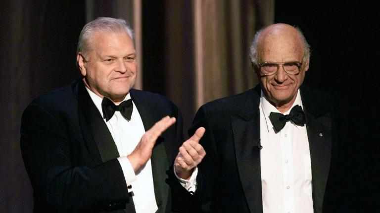 In this June 6, 1999 file photo, actor Brian Dennehy, left, applauds playwright, Arthur Miller, before awarding him the Lifetime Achievement Award at the Tony Awards in New York. (AP Photo / Kathy Willens, File)