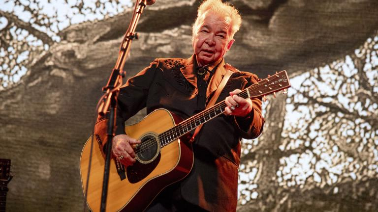 This June 15, 2019 file photo shows John Prine performing at the Bonnaroo Music and Arts Festival in Manchester, Tennessee. (Photo by Amy Harris / Invision / AP, File)