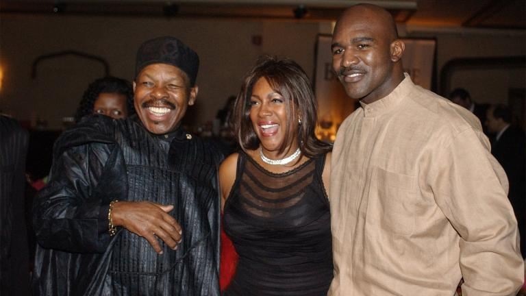 FILE - In this Feb. 20, 2003 file photo, Lloyd Price, left, and Mary Wilson, of the Supremes, pose for a photograph with boxer Evander Holyfield during the reception of the 13th Annual Pioneer Awards presented by the Rhythm & Blues Foundation in New York. (AP Photo / Frank Franklin II, File)