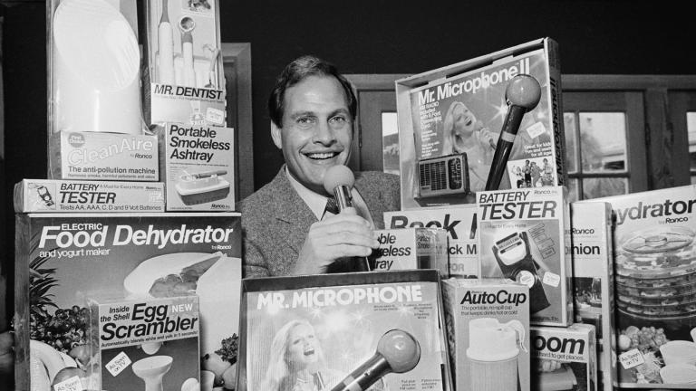 In this Wednesday, Dec. 8, 1982 file photo, Ron Popeil, the man behind those late-night, rapid-fire television commercials that sell everything from the Mr. Microphone to the Pocket Fisherman to the classic Veg-a-Matic, sits surrounded by his wares in his office in Beverly Hills, Calif. (AP Photo / Reed Saxon, File)