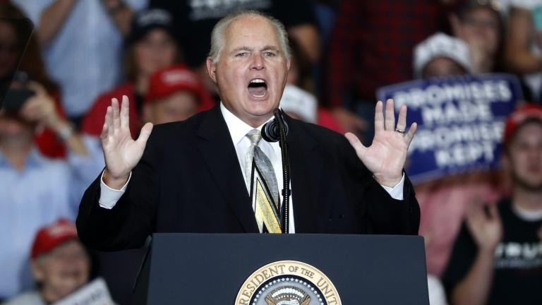 This Nov. 5, 2018 file photo shows radio personality Rush Limbaugh introducing President Donald Trump at the start of a campaign rally in Cape Girardeau, Mo. (AP Photo / Jeff Roberson, File)