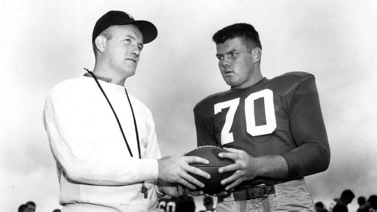 In this September 1958 file photo, Notre Dame football coach Terry Brennan, left, talks with tackle Bronko Nagurski Jr. during practice in South Bend, Ind. (AP Photo, File)