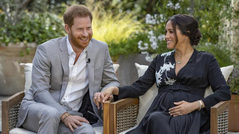 This image provided by Harpo Productions shows Prince Harry, left, and Meghan, Duchess of Sussex, speaking about expecting their second child during an interview with Oprah Winfrey. (Joe Pugliese / Harpo Productions via AP)