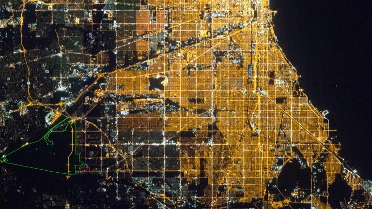 Chicago as seen from the International Space Station. The Palos Preserves Urban Night Sky Place is outlined in green. (Courtesy of the Earth Science and Remote Sensing Unit, NASA Johnson Space Center)