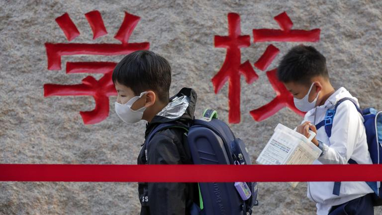 In this Sept. 7, 2020 file photo, students wearing face masks to help curb the spread of the coronavirus walk in line as they arrive at a primary school in Beijing. (AP Photo / Andy Wong, File)