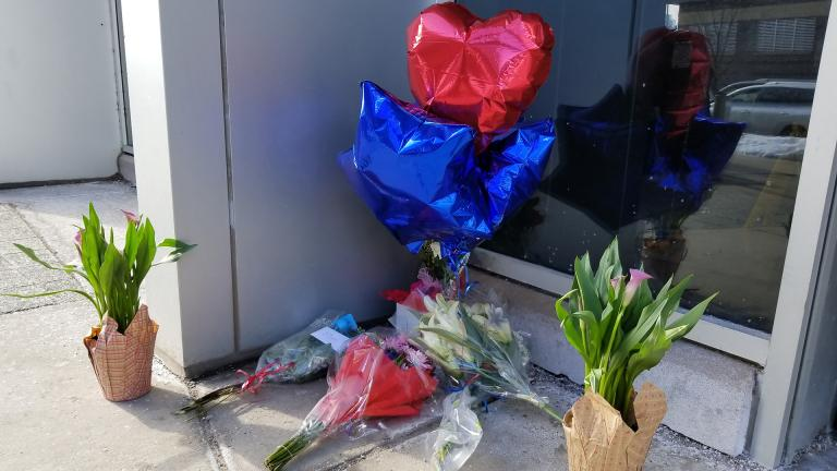 Flowers and balloons are left as a makeshift memorial to CPD Cmdr. Paul Bauer outside his 18th District precinct. (Matt Masterson / Chicago Tonight)