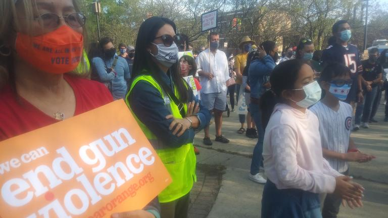 Community members take part in a peace walk in Albany Park to address gun violence on Sunday, Sept. 20, 2020. (Annemarie Mannion / WTTW News)