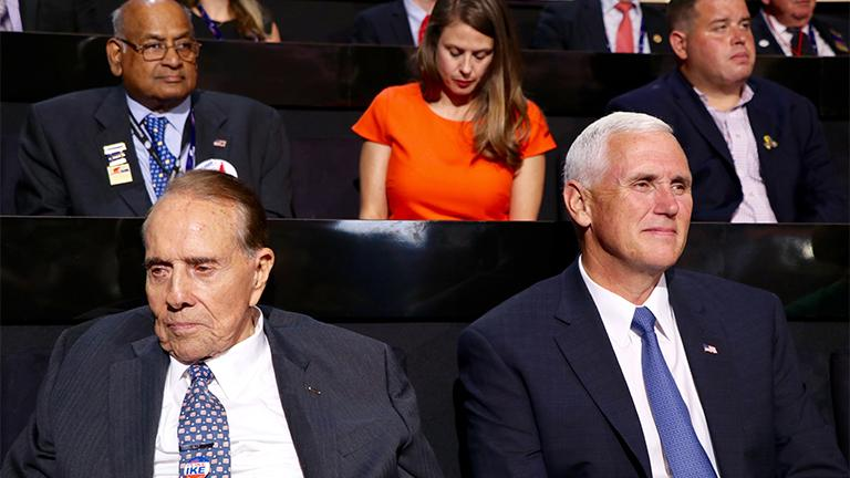 Former U.S. Sen. Bob Dole seated with Indiana Gov. Mike Pence at the Republican National Convention on July 18, 2016. (Evan Garcia)