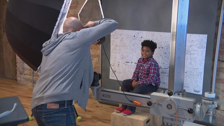 Chicago photographer Jeff Dahlgren takes a portrait at Throop Studio. (WTTW News)