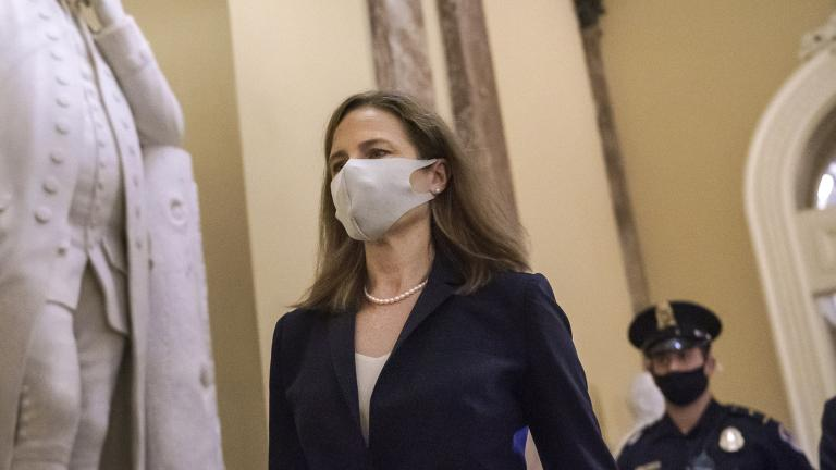 Judge Amy Coney Barrett, President Donald Trump's nominee for the Supreme Court, arrives for closed meetings with senators, at the Capitol in Washington, Wednesday, Oct. 21, 2020. (AP Photo / J. Scott Applewhite)