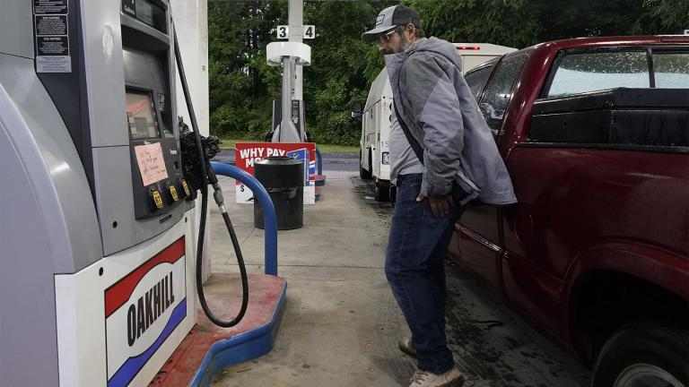 A customer looks at a hand written sign posted on a gas pump, showing that the service station is out of all grades of fuel Wednesday, May 12, 2021, in Charlotte, N.C. (AP Photo / Chris Carlson)