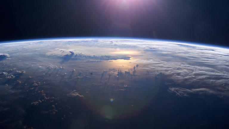 This view of Earth's horizon as the sun sets over the Pacific Ocean was taken by an Expedition 7 crew member onboard the International Space Station (ISS). Anvil tops of thunderclouds are also visible. (NASA)