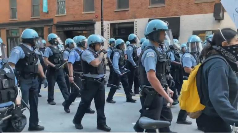 Chicago police officers monitor a crowd of protesters following the death of George Floyd. (WTTW News)