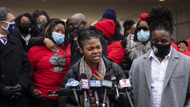 Clifftina Johnson (back, left), Tafara Williams' mother, cries as her daughter, Sasha Williams, sings during a press conference outside Waukegan's city hall complex, Tuesday morning, Oct. 27, 2020. (Ashlee Rezin Garcia / Chicago Sun-Times via AP)