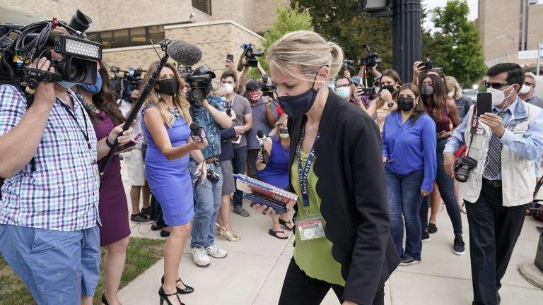 Kasey Morgan, a public information officer for the Lake County Court, walks away from reporters outside the Lake County courthouse following the extradition hearing for Kyle Rittenhouse Friday, Aug. 28, 2020, in Waukegan, Ill.(AP Photo / Morry Gash)