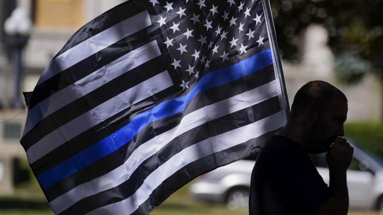 An unidentified man participates in a Blue Lives Matter rally Sunday, Aug. 30, 2020, in Kenosha, Wis. (AP Photo / Morry Gash)
