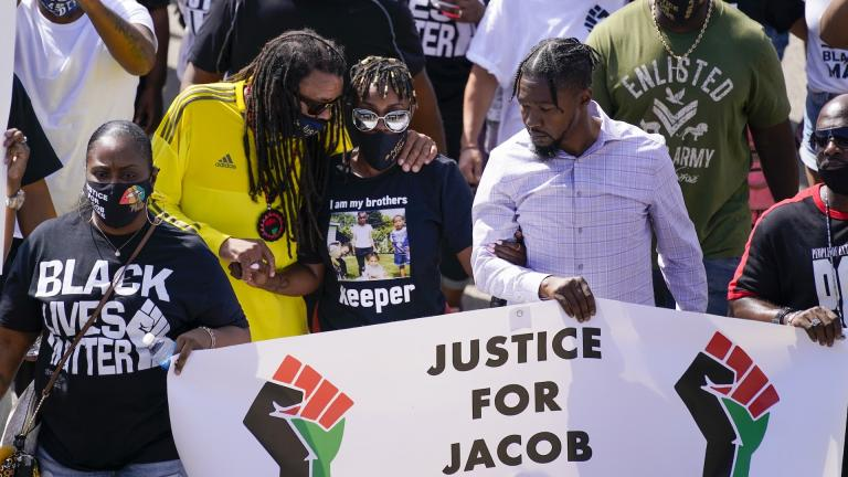In this Aug. 29, 2020, file photo, Jacob Blake's sister Letetra Widman, center, and uncle Justin Blake, left, march at a rally for Jacob Blake Saturday, Aug. 29, 2020, in Kenosha, Wis. (AP Photo/Morry Gash, File)