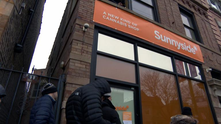 Workers put the finishing touches on the Sunnyside dispensary in Lakeview on Dec. 30, 2019, just two days before recreational marijuana became legal in Illinois. (WTTW News)