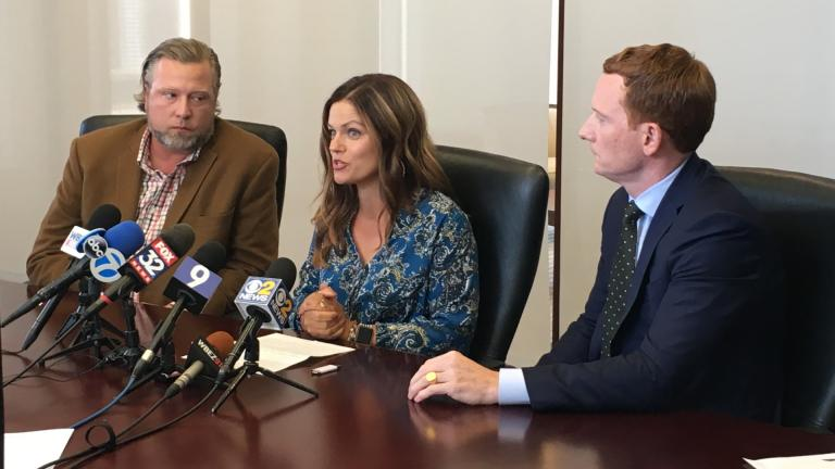 New Lenox residents Tim and Ruby Johnson, left, speak at a press conference Thursday about the recent hospitalization of their daughter, Piper, with their attorney Michael Gallagher, right. (Kristen Thometz / WTTW News)