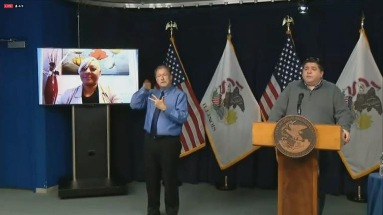 Gov. J.B. Pritzker introduces Steger resident Shanna Siegers during his COVID-19 briefing Tuesday, Dec. 1, 2020. (WTTW News)
