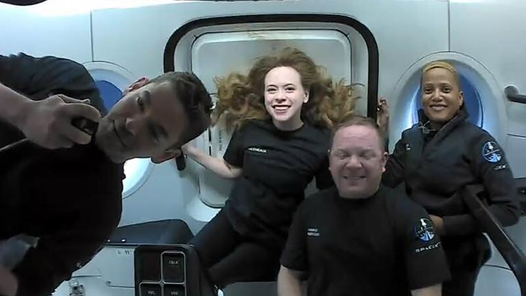 This photo provided by SpaceX shows the passengers of Inspiration4 in the Dragon capsule on their first day in space. They are, from left, Jared Isaacman, Hayley Arceneaux, Chris Sembroski and Sian Proctor. (SpaceX via AP)