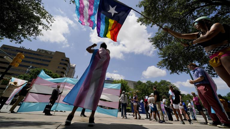 FILE - In this Thursday, May 20, 2021 file photo, demonstrators gather on the steps to the State Capitol to speak against transgender-related legislation bills being considered in the Texas Senate and Texas House in Austin, Texas. (AP Photo / Eric Gay, File)
