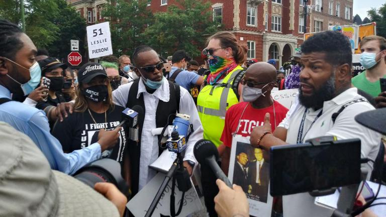 Members of the Chicago Activist Coalition for Justice, led by Rabbi Michael Ben Yosef (center, in white shirt with black vest), speak with the media at a protest against police brutality on Saturday, Aug. 15, 2020 in Chicago. (Annemarie Mannion / WTTW News)