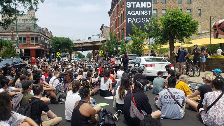 A crowd gathers on Damen Avenue in Wicker Park on Sunday, June 21, 2020. (Amanda Vinicky / WTTW News)