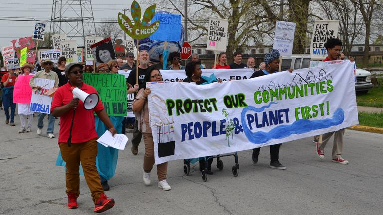 Community Strategy Group organizer April Friendly, left, leads a rally Wednesday during EPA head Scott Pruitt's visit to East Chicago. (Alex Ruppenthal / Chicago Tonight)