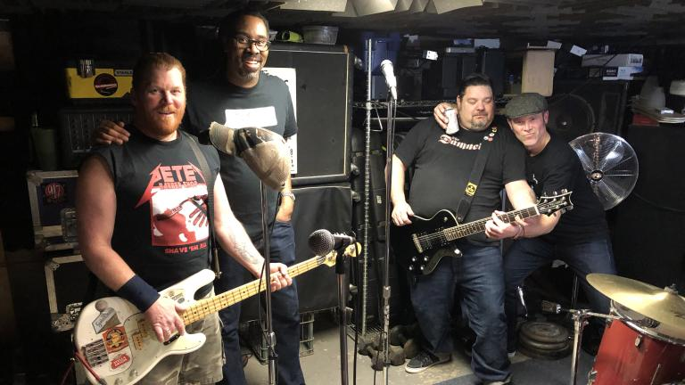 The Bollweevils pose after a rehearsal in a Northwest Side basement. From left: Pete Mittler, Daryl Wilson, Ken Fitzner, Pete Mumford. (Jay Shefsky / Chicago Tonight)