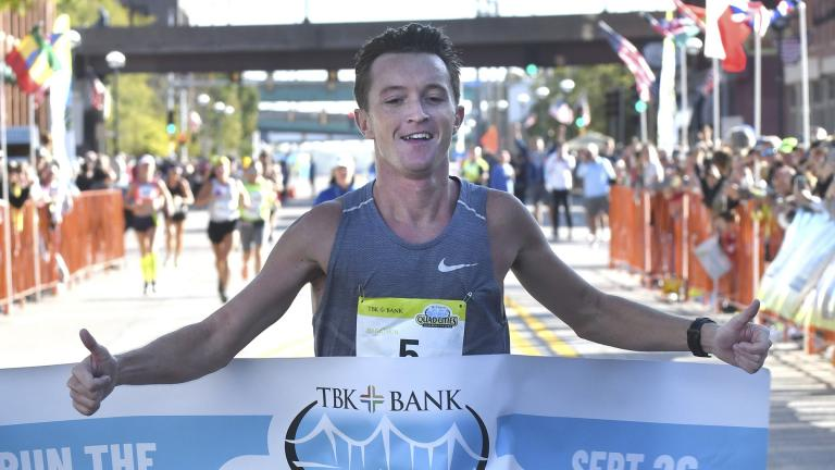 Tyler Pence of Springfield, Ill., finishes first in the TBK Bank Quad Cities Marathon on Sunday, Sept. 26, 2021, in Moline, Ill. (Gary L. Krambeck / Quad City Times via AP)