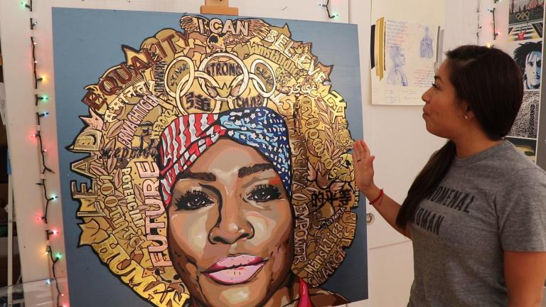 "Artist Anna Dominguez, the self-described ""Queen of Tape,"" stands before a portrait of tennis player Serena Williams. She made the work of art using thousands of pieces of tape. (Evan Garcia / WTTW News)"