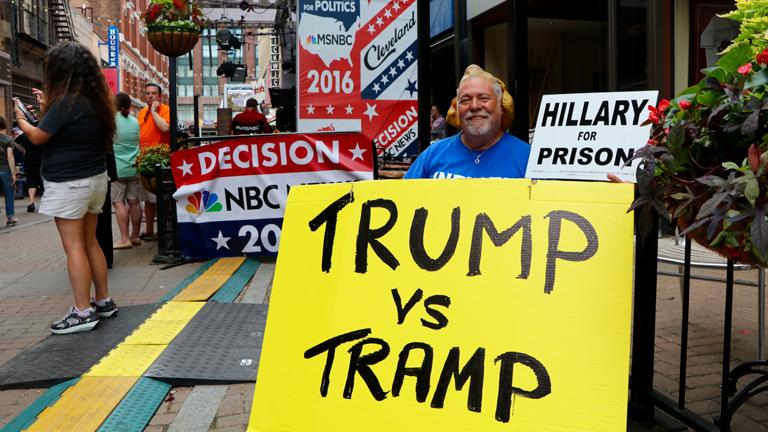 Anti-Hillary Clinton protester Bob Kunst, 74, from Miami Beach, Florida, demonstrates outside of the Quicken Loans Arena. (Evan Garcia)