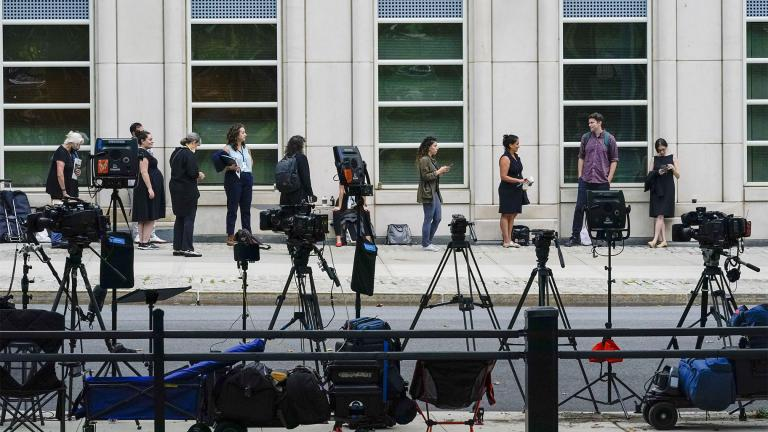 Television crew equipment is set up across the street as reporters and spectators line up outside Brooklyn Federal court for opening statements in R&B star R. Kelly's long-anticipated federal trial arising from years of allegations that he sexually abused women and girls, Wednesday, Aug. 18, 2021, in New York. (AP Photo / Mary Altaffer)