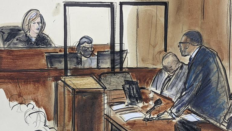 In this illustration drawn from a video feed, R. Kelly, right, stands and responds to Judge Ann Donnelly's question whether or not he has decided to take the stand in his own defense, Wednesday, Sept. 22, 2021, in New York. (AP Photo / Elizabeth Williams)