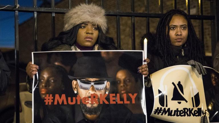 #MuteRKelly supporters protest outside R. Kelly's studio, Wednesday, Jan. 9, 2019, in Chicago. (Ashlee Rezin / Chicago Sun-Times via AP, File)