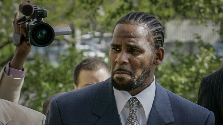This photo from Friday May 9, 2008, shows R. Kelly arriving for the first day of jury selection in his child pornography trial at the Cook County Criminal Courthouse in Chicago. (AP Photo / Charles Rex Arbogast, File)