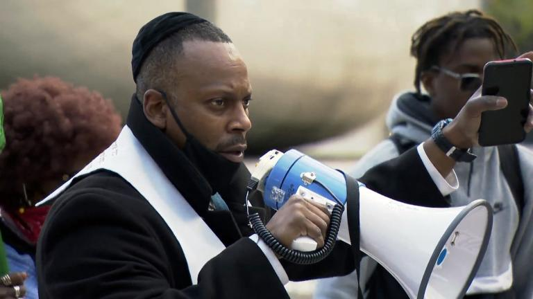 Rabbi Michael Ben Yosef of the Chicago Activist Coalition For Justice speaks during a demonstration in Millennium Park on Thursday, April 15, 2021. (WTTW News)