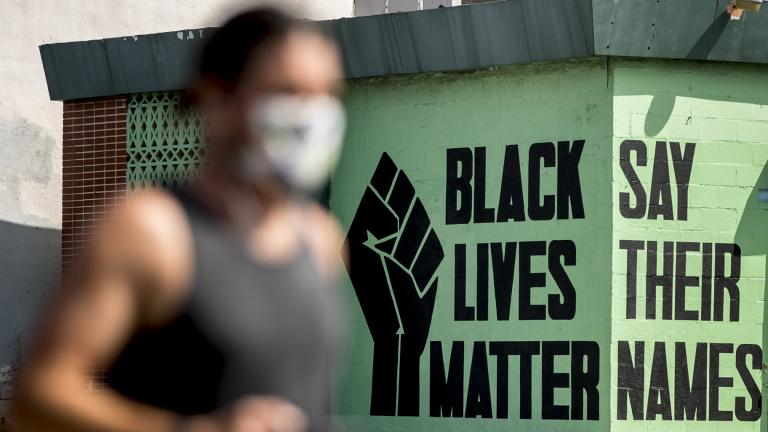 In this July 13, 2020, file photo, a black lives matter mural is visible in the Shaw neighborhood in Washington. (AP Photo / Andrew Harnik, File)
