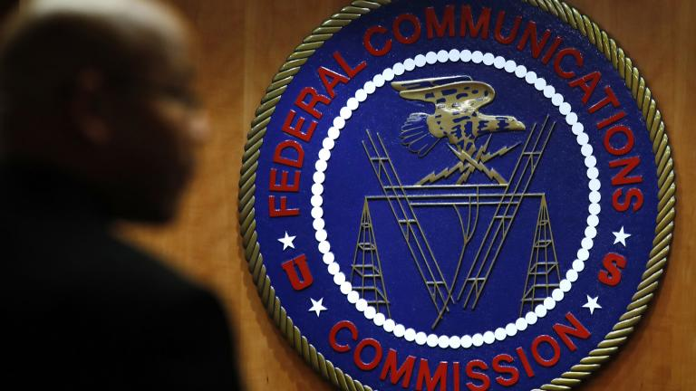 This Dec. 14, 2017, file photo, shows the seal of the Federal Communications Commission (FCC) before a meeting in Washington. (AP Photo / Jacquelyn Martin, File)