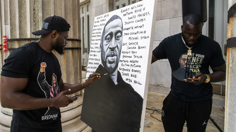Artist Dennis Owes, 31, from Ghana gives the last touch to his portrait of George Floyd during a rally on Sunday, May 23, 2021, in Brooklyn borough of New York. (AP Photo / Eduardo Munoz Alvarez)